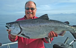 Smiling Angler with Large Salmon